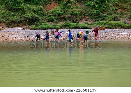 Ha Giang, Vietnam October 23, 2014: A group of ethnic minorities are washing linen bark as raw materials for weaving in the traditional way in Ha Giang, Vietnam