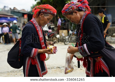 HA GIANG, VIETNAM - SEPTEMBER 20, 2015: Unidentified people of diferent ethnic groups in Lung Phin market. Lung Phin market is one of the most typical hill tribe markets in Vietnam.