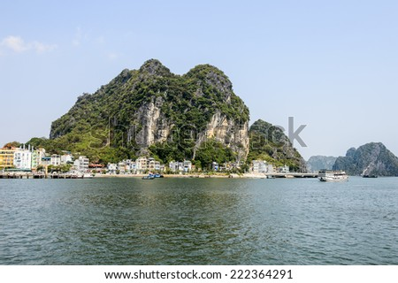 Ha Long bay islands in the Indochina sea. UNESCO World Heritage site - stock photo