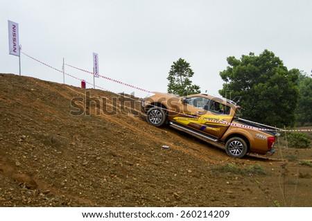 Ha Noi, Viet Nam - March 9, 2015: Nissan Navara NP300 2015 car crossing steep in test drive in Vietnam - stock photo