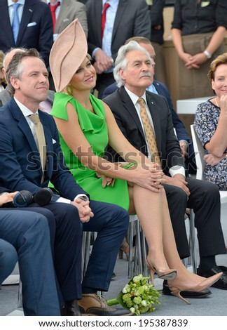 HAAKSBERGEN, NETHERLANDS - MAY 16: Queen Maxima of the Netherlands is listening during a speech just before she opened the new building of factory UNIPRO, May 16, 2014 in the Netherlands