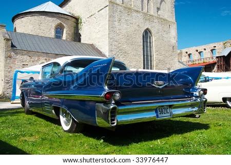 HAAPSALU, ESTONIA - JULY 18: American Beauty Car Show, showing blue 1958 Cadillac Coupe De Ville, rear view on July 18, 2009 in Haapsalu, Estonia - stock photo
