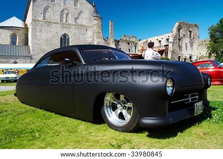HAAPSALU, ESTONIA - JULY 18: American Beauty Car Show, showing mat black 1949 Mercury Custom, front view on July 18, 2009 in Haapsalu, Estonia - stock photo