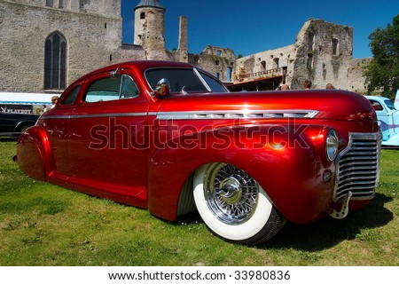 HAAPSALU, ESTONIA - JULY 18: American Beauty Car Show, showing red 1941 Chevrolet Coupe Justiina, front view on July 18, 2009 in Haapsalu, Estonia - stock photo