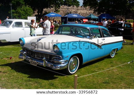 HAAPSALU, ESTONIA - JULY 18: American Beauty Car Show, showing white and blue 1956 Ford Fairlane 2D HT, front view on July 18, 2009 in Haapsalu, Estonia - stock photo