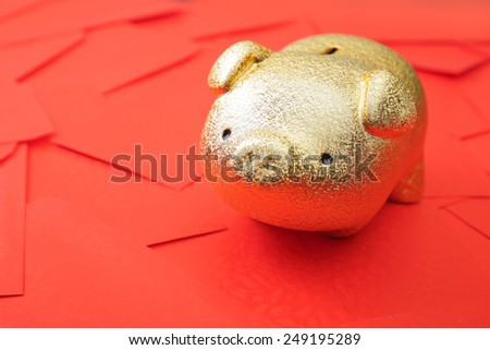 Haapy chinese new year - Golden piggy bank with red envelope background - stock photo