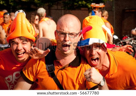 HAARLEM, NETHERLANDS - JULY 6: Netherlands fans celebrate as their football team went into the final of 2010 World Cup July 6,2010  in Haarlem, Netherlands. - stock photo