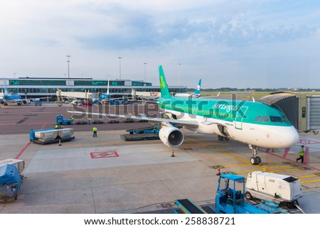 HAARLEMMERMEER, NETHERLANDS - JULY 27, 2014: An Aerlingus Airbus A320 is being prepared for its next flight. - stock photo