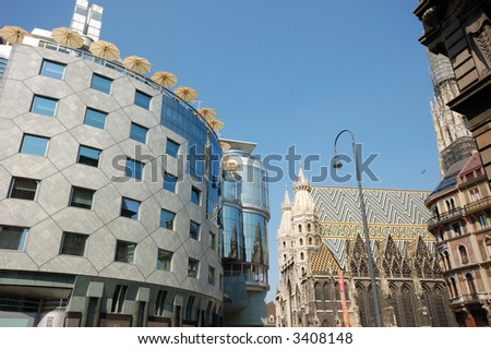 Haas-Haus and St. Stephen's Cathedral at the Stephansplatz in Vienna, Austria - stock photo