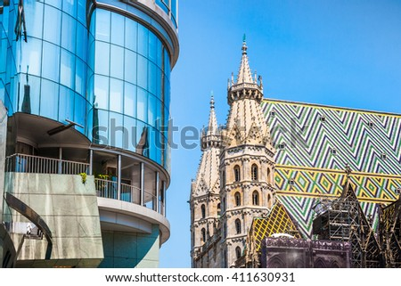 Haas Haus with famous St. Stephen's Cathedral at Stephansplatz in Vienna, Austria - stock photo
