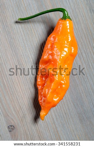 habanero mustard on wooden background - stock photo