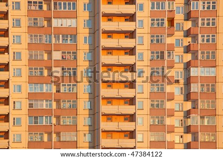 Habitation orange block shined with the sun on a decline