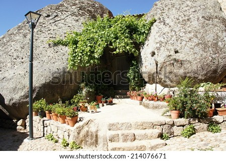 Habitation with boulder in Monsanto - the most Portuguese village of Portugal - stock photo