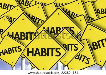 Habits written on multiple road sign - stock photo