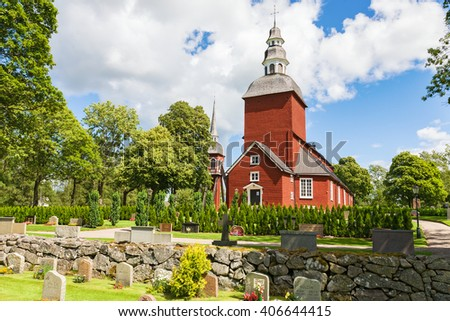 Habo, Sweden-June 17, 2008 - Cemetery with a red Wooden Church