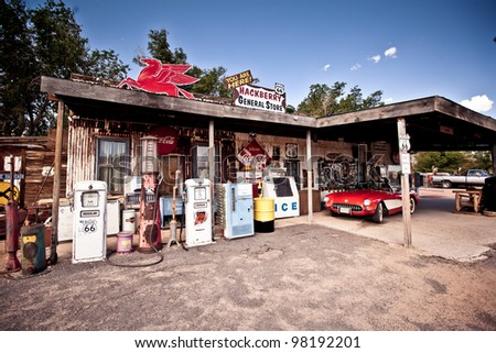 HACKBERRY - JUL 13: Hackberry General Store with a 1957 red Corvette car in front on July 13, 2011 in Hackberry , Arizona, USA. Hackberry General Store is a popular museum of old Route 66 - stock photo