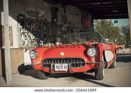 HACKBERRY, USA - SEPTEMBER 25, 2011: historic red Chevrolet Corvette at Hackberry General Store on Route 66, Hackberry, Arizona, United States of America, sept 25 2011 - stock photo