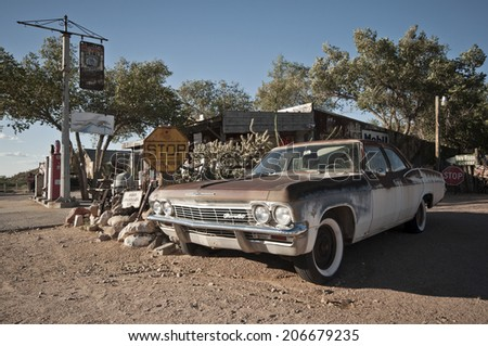 HACKBERRY, USA - SEPTEMBER 25, 2011: rusty Chevrolet car wreck at a historic gas station at Route 66, Hackberry, Arizona, United States of America, sept 25 2011 - stock photo