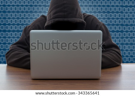 hacker and laptop on white background