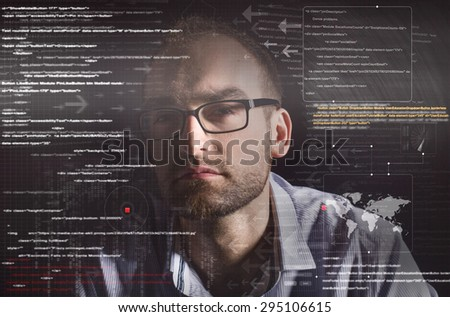 hacker face with graphic user interface around - stock photo