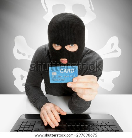 Hacker in black mask with USA state flag - Jolly Roger - stock photo
