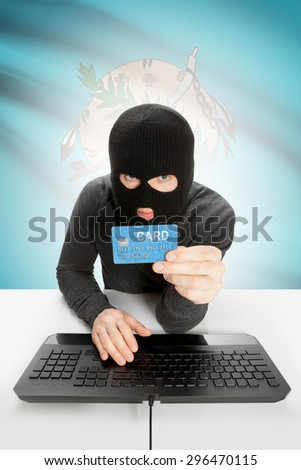 Hacker in black mask with USA state flag on background - Oklahoma - stock photo