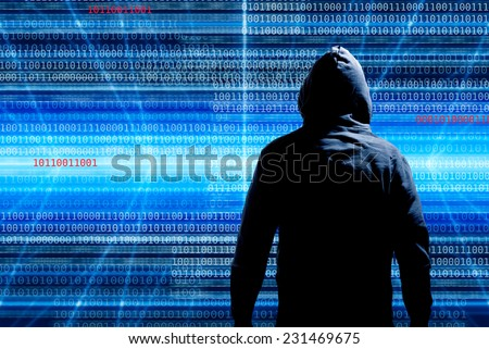 hacker in front of a background with binary code - stock photo