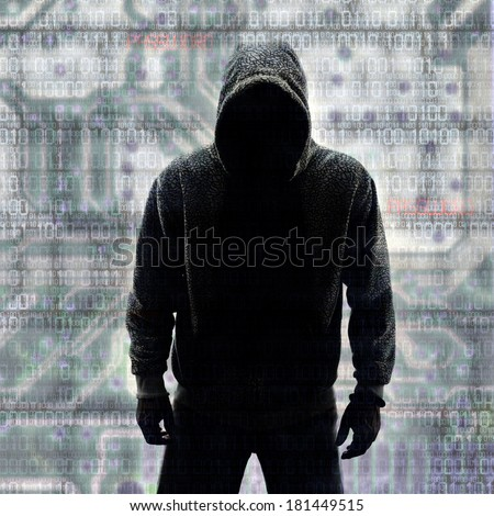 Hacker in Silhouette with Binary codes in Background - stock photo