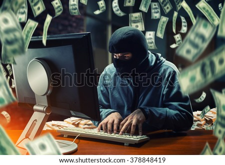 Hacker in the office - stock photo