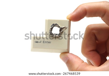 Hacker's hand picking up computer enter button with a hole representing computer security breach isolated - stock photo