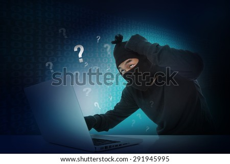Hacker stealing data on laptop computer with question mark sign icon. - stock photo