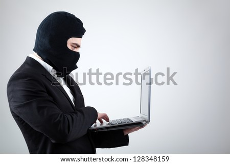 Hacker stealing information from laptop
