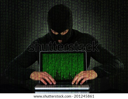 Hacker typing on laptop with binary code - stock photo