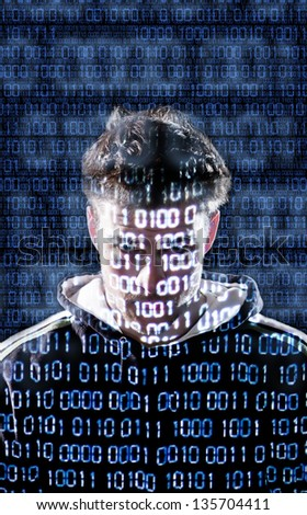 Hacker with binary codes looking directly to the camera - stock photo