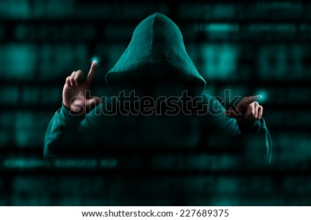 Hacker with green hood attacking internet security - stock photo