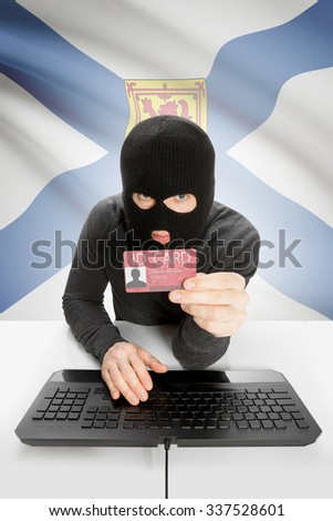 Hacker with ID card in hand and Canadian province flag on background - Nova Scotia - stock photo