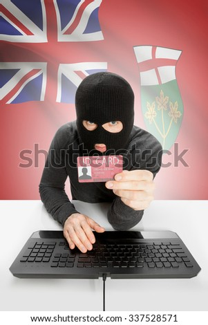 Hacker with ID card in hand and Canadian province flag on background - Ontario - stock photo