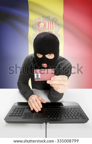 Hacker with ID card in hand and flag on background - Andorra - stock photo