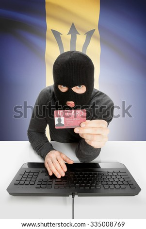 Hacker with ID card in hand and flag on background - Barbados - stock photo