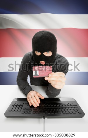 Hacker with ID card in hand and flag on background - Costa Rica - stock photo