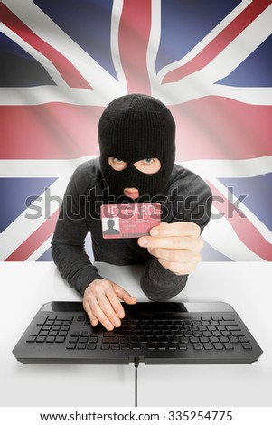 Hacker with ID card in hand and flag on background - United Kingdom - stock photo