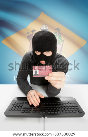 Hacker with ID card in hand and USA states flag on background - Delaware - stock photo