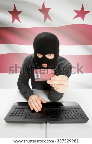 Hacker with ID card in hand and USA states flag on background - District of Columbia - stock photo