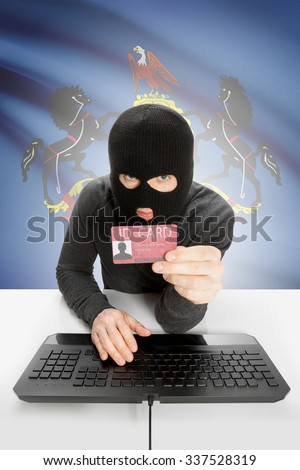 Hacker with ID card in hand and USA states flag on background - Pennsylvania - stock photo