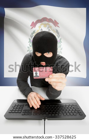 Hacker with ID card in hand and USA states flag on background - West Virginia - stock photo