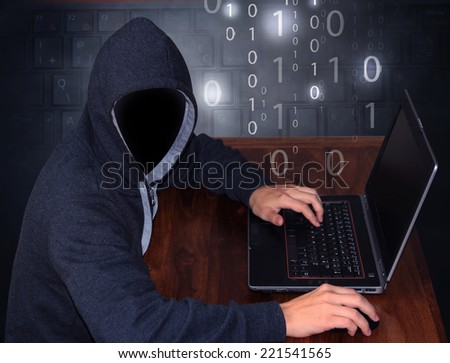 hacker with laptop - stock photo