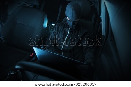 Hacking Car Systems. Hacker with His Computer at Work.  - stock photo