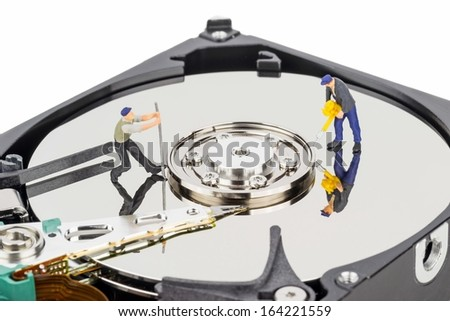 Hacking or repairing a computer hard disc drive concept - stock photo