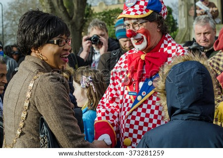 HACKNEY, LONDON - FEBRUARY 7, 2016:  Councilor Sade Etti, Deputy Speaker of Hackney Council, is welcomed to the Annual Clown Service by Bluebottle, also known as Tony Eldridge.