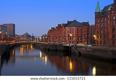 hafencity and speicherstadt in hamburg, germany at sunset - stock photo